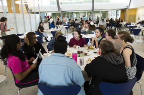 Moore students chatting in the dining hall.