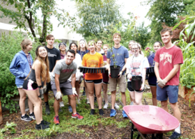 Picture of Urban Plunge 2020 students participating in a garden cleanup.