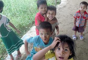 Children look up at the camera in Dala, Myanmar